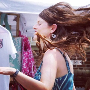Yoga teacher and Dragonfly Moondance owner Kimberly Renner dancing at a community art festival.